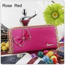 Elegantní dámská kožená peněženka s mašlí a krystaly - sytě růžová