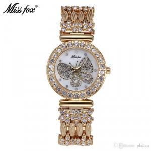 Luxusní zlaté dámské hodinky osázené krystaly s motýlem