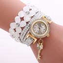 Moderní dámské hodinky osázené krystaly a přívěškem bílé