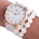Moderní dámské hodinky osázené krystaly a korálky bílé
