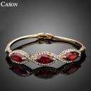 Luxusní zlatý náramek s krystaly a 3 červenými zirkony